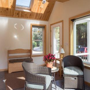Idéer för små maritima uterum, med takfönster, klinkergolv i keramik och svart golv