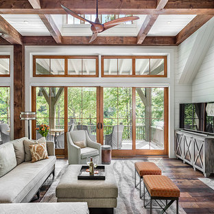 Large Minimalist Dark Wood Floor Sunroom Photo In Other With A Standard  Fireplace, A Stone