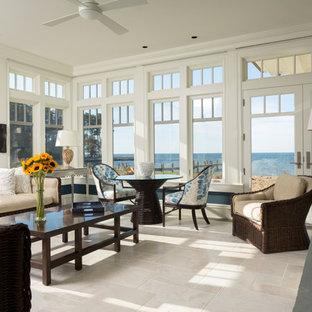 Ispirazione per un'ampia veranda classica con pavimento in marmo, camino classico e soffitto classico