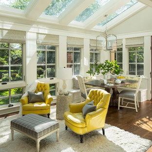 Ispirazione per una veranda classica con pavimento in legno massello medio, soffitto in vetro e pavimento marrone