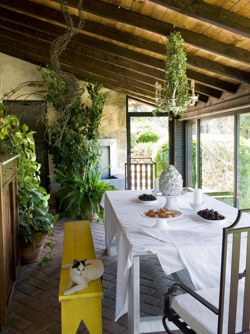 Foto e idee per verande veranda shabby chic style for Proiettato in veranda con camino