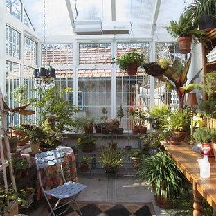 Idéer för stora vintage uterum, med betonggolv och takfönster