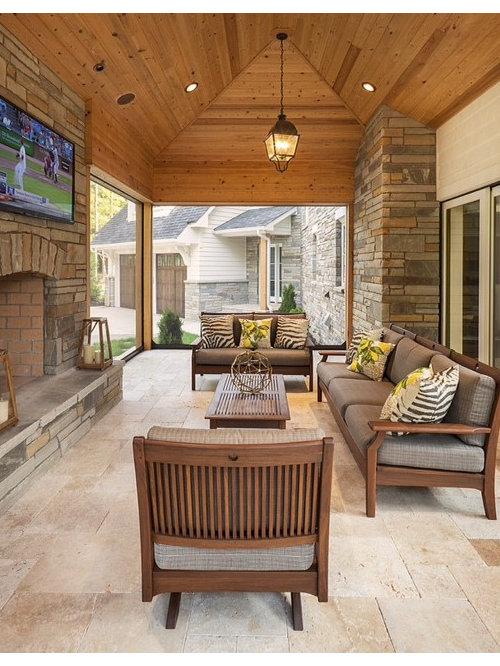 Foto e idee per verande veranda con camino classico for Proiettato in veranda con camino