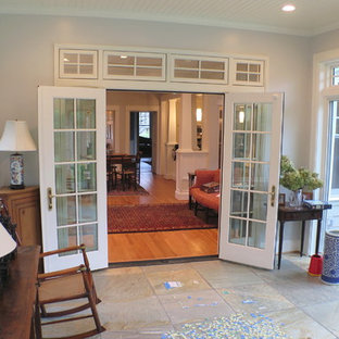 Example of a small arts and crafts slate floor sunroom design in DC Metro with a standard ceiling