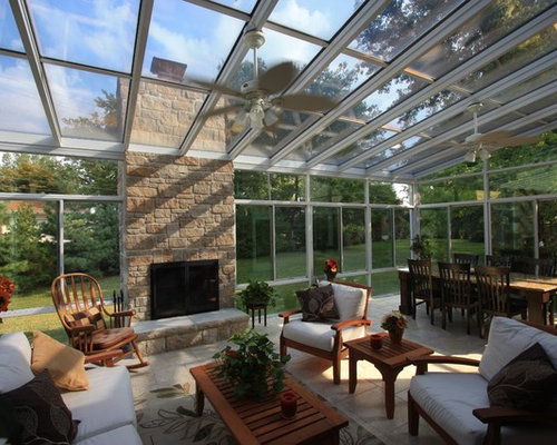 Large sunroom design ideas remodels photos with a stone for Sunroom sizes