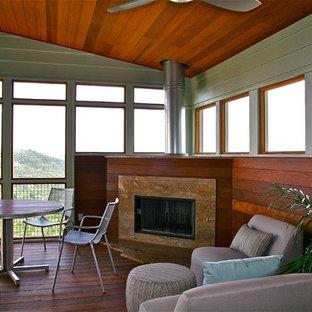 Idee per una veranda minimal di medie dimensioni con camino lineare Ribbon, soffitto classico e pavimento marrone