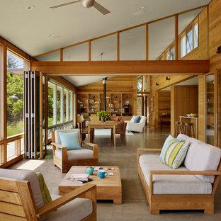 Immagine di una grande veranda contemporanea con pavimento in cemento, soffitto classico e pavimento grigio