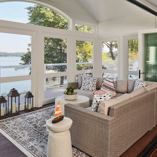 Inspiration for a coastal dark wood floor and brown floor sunroom remodel in Milwaukee with no fireplace and a standard ceiling