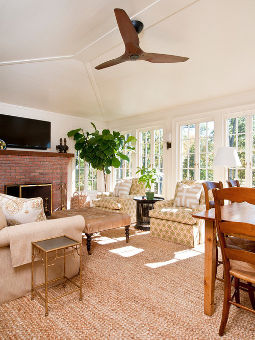 Best farmhouse sunroom with a brick fireplace surround for Farmhouse sunroom ideas