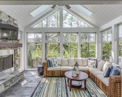 Example Of A Classic Gray Floor And Painted Wood Sunroom Design In Cleveland With