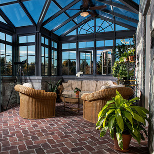 Design ideas for a large classic conservatory in Denver with brick flooring, no fireplace and a glass ceiling.
