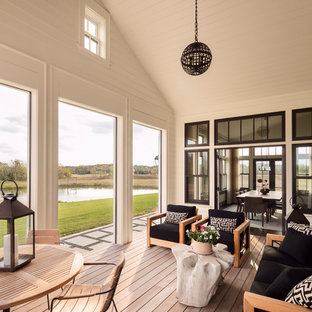 Inspiration for a contemporary light wood floor and beige floor sunroom remodel in Milwaukee