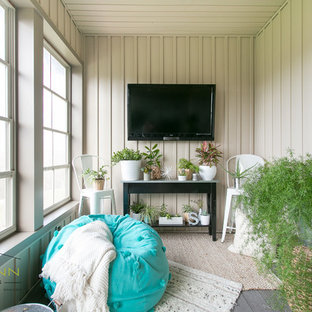 Inspiration for a small beach style conservatory in Cleveland with laminate floors.