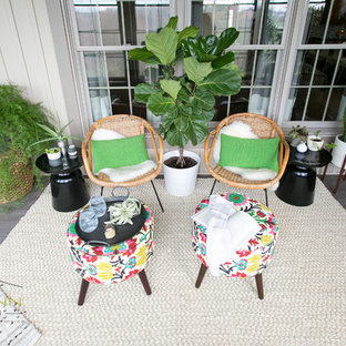 This is an example of a small beach style conservatory in Cleveland with laminate floors.