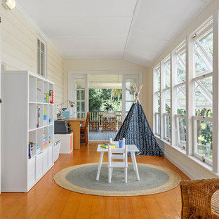 Design ideas for a country sunroom in Brisbane with medium hardwood floors, a standard ceiling and brown floor.
