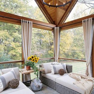 Sunroom - farmhouse gray floor sunroom idea in Nashville with a skylight