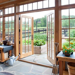 Large mountain style slate floor sunroom photo in Other with a standard ceiling