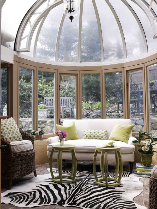 victorian sunroom idea in new york with a glass ceiling