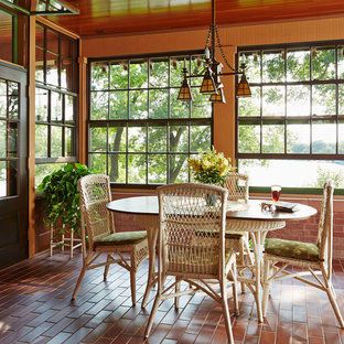 Inspiration for a mid-sized craftsman brick floor and red floor sunroom remodel in Minneapolis with no fireplace and a standard ceiling