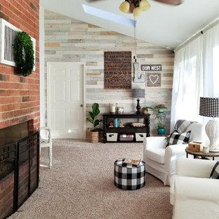 Idées déco pour une véranda de taille moyenne avec moquette, une cheminée standard, un manteau de cheminée en brique, un plafond standard et un sol beige.
