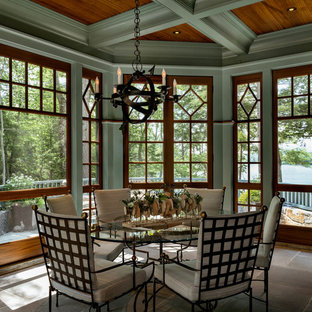 Inspiration for a craftsman gray floor sunroom remodel in Other with a standard ceiling