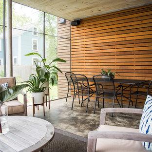 Idées déco pour une véranda contemporaine avec un plafond standard et un sol multicolore.
