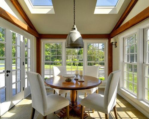 Foto e idee per verande veranda con pavimento in pietra for Proiettato in veranda con camino