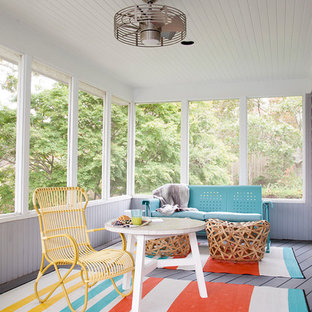 Example of an eclectic gray floor sunroom design in New York