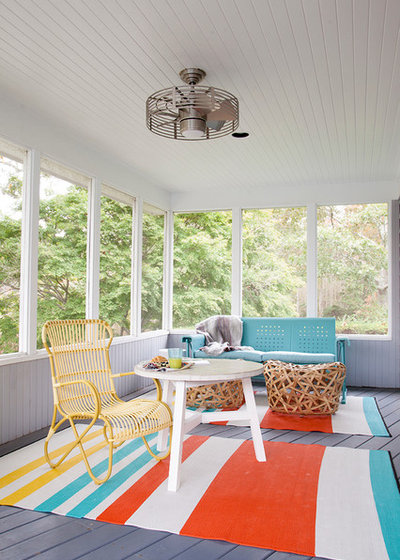 Eclectic Sunroom by Abaca Interiors