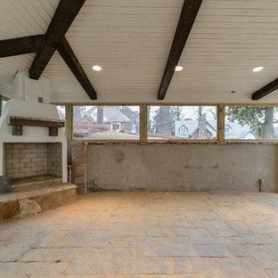 Idées déco pour une grand véranda classique avec un sol en ardoise, une cheminée d'angle, un manteau de cheminée en béton et un plafond standard.