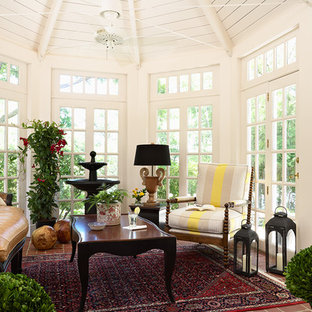 Photo of a traditional conservatory in Minneapolis with brick flooring and a standard ceiling.