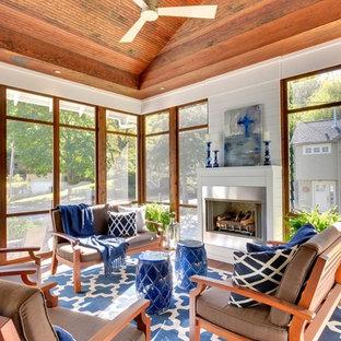 Idée de décoration pour une véranda vintage de taille moyenne avec moquette, une cheminée standard et un plafond standard.