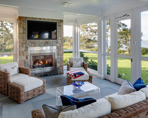 Foto e idee per verande veranda al mare con camino classico for Proiettato in veranda con camino