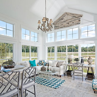 Example of a beach style sunroom design in DC Metro with a standard ceiling