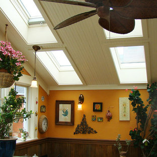 Sunroom - small country travertine floor and multicolored floor sunroom idea in Denver with a skylight