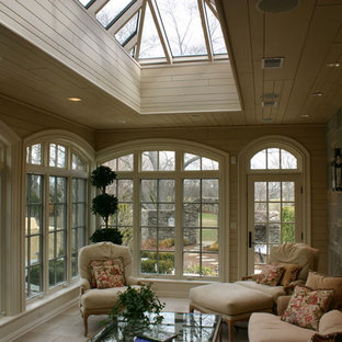 Sunroom - mid-sized traditional limestone floor and beige floor sunroom idea in Chicago with no fireplace and a skylight