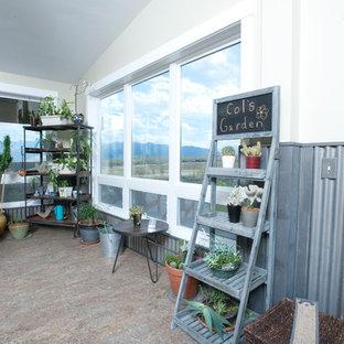 Ispirazione per una grande veranda industriale con pavimento in linoleum
