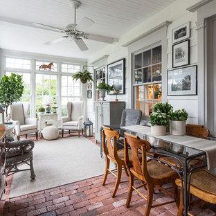 Idee per una veranda classica con pavimento rosso