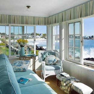 Idee per una veranda costiera con moquette, soffitto classico e pavimento giallo