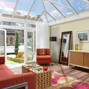 Example of a mid-sized trendy dark wood floor sunroom design in New York with no fireplace and a glass ceiling