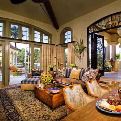 Sunroom - large mediterranean terra-cotta tile sunroom idea in Atlanta with a standard ceiling