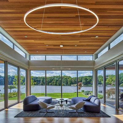 Inspiration for a contemporary light wood floor sunroom remodel in Grand Rapids with no fireplace and a standard ceiling