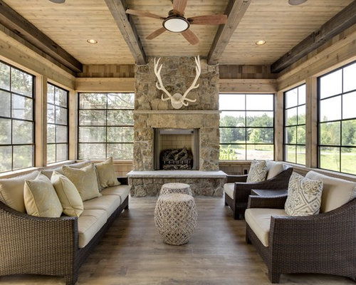 Country sunroom design ideas renovations photos with a for Sunroom with fireplace designs