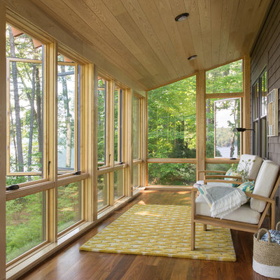 Mid-sized mountain style medium tone wood floor and brown floor sunroom photo in Portland Maine with a standard ceiling