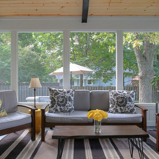 Inspiration for a timeless slate floor sunroom remodel in Chicago with a stone fireplace