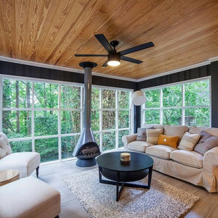 Inspiration for a medium sized contemporary conservatory in Atlanta with porcelain flooring, a hanging fireplace, a metal fireplace surround, a standard ceiling and brown floors.