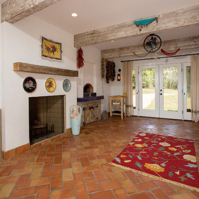 Sunroom - mediterranean terra-cotta tile and orange floor sunroom idea in DC Metro with a wood stove, a tile fireplace and a standard ceiling