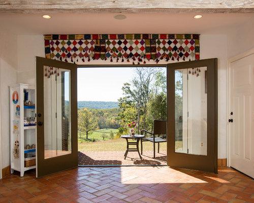 Foto e idee per verande veranda mediterranea con stufa a for Stufa a legna per veranda protetta