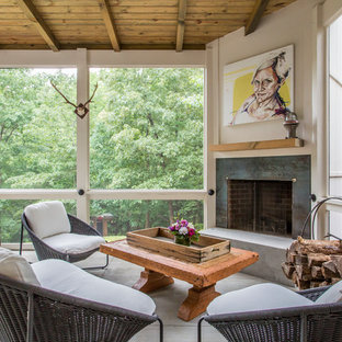 This is an example of a rustic conservatory in Atlanta with concrete flooring, a corner fireplace and a standard ceiling.