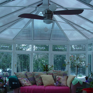 Example of a mid-sized classic ceramic tile sunroom design in New York with a skylight